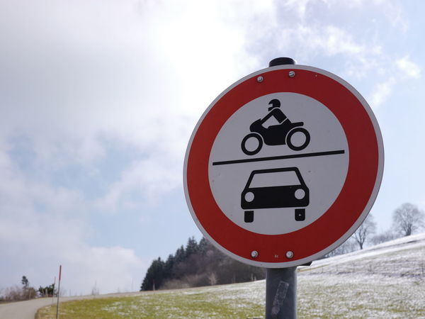 Trafficsign in south Germany Allgäu Guiding Traffic Beauty In Nature Close-up Communication Day Field Grass Guidance Guide Landscape Nature No People Outdoors Road Sign Sky Speed Limit Sign Traffic Sign Tree