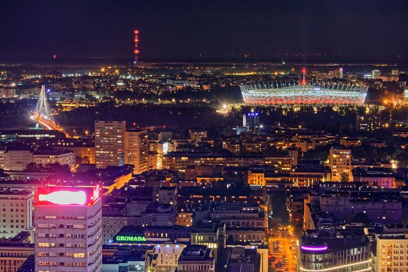 Capital Cities  Poland Warsaw Nightscape Architecture Building Exterior Illuminated City Night Built Structure Cityscape Building Office Building Exterior City Life Skyscraper Urban Skyline High Angle View Travel Destinations Modern Outdoors