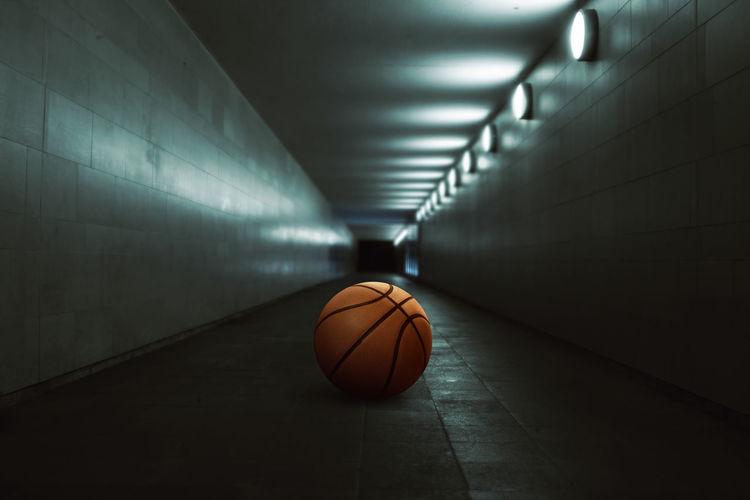 Basketball in illuminated tunnel