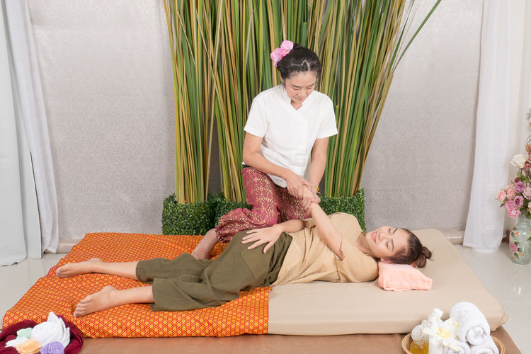 High angle view of woman giving massage to customer at spa