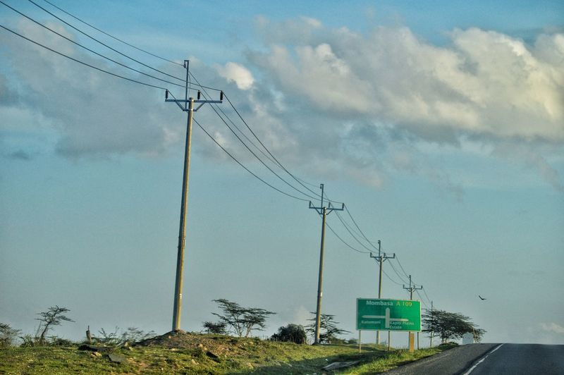 Electricity  Power Supply Power Line  Technology Connection Directional Sign Directions Traveling Roadtrip Road Sign Kenya Kenyanphotographer Traffic Athi River Outdoor Photography Kenya❤