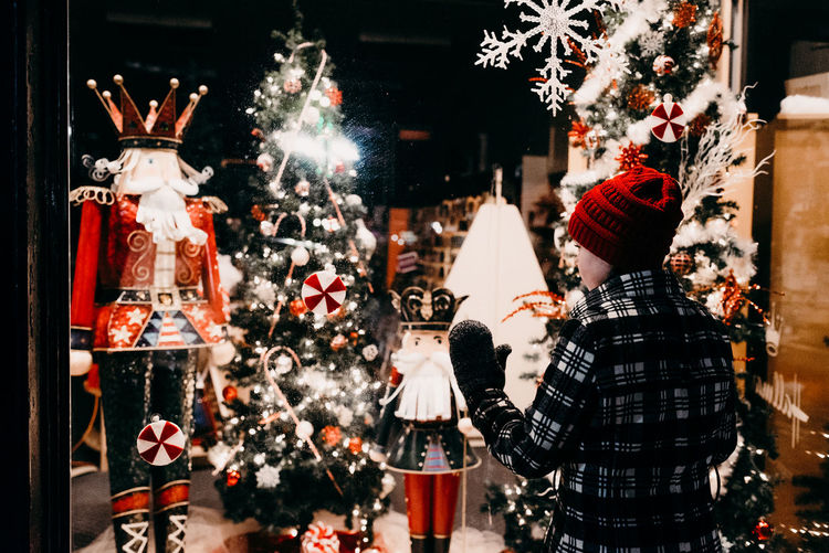 Christmas Celebration Christmas Decoration Winter Decoration Holiday Illuminated christmas tree Real People Lifestyles Holiday - Event Cold Temperature People Human Representation Rear View Event Hat Women Christmas Ornament Christmas Market Warm Clothing Childhood Girl