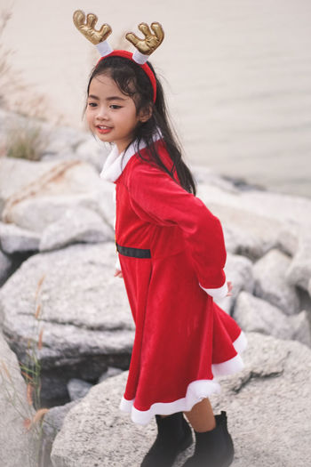 Little Santy/Reindeer on Stone dam at sea side.Little Girl in Santa Claus dress with Reindeer Headband. Santy  Santa Santa Claus Reindeer Stone Dam Sea Sea Side Thailand Winter Fashion Girl Little Girl Kid Asian  One Person Red Childhood Real People Child Girls Leisure Activity Standing Lifestyles Clothing Full Length Females Women Three Quarter Length Cute Solid Looking At Camera Innocence Hairstyle