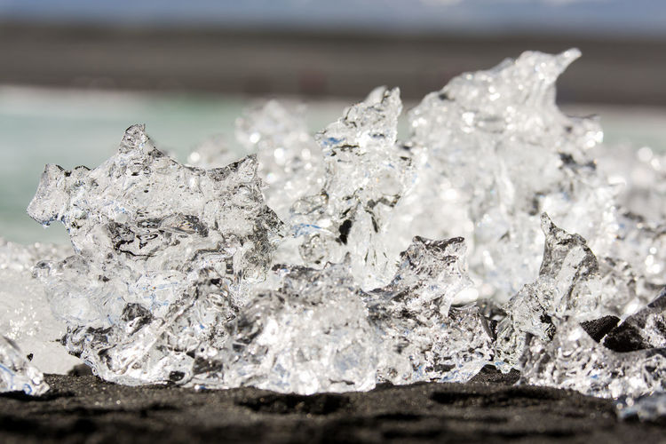Diamond Beach in Iceland - Icebergs melting on Black Sand Crystal Selective Focus Close-up Solid Shiny Ice Jewelry Water Quartz Sea Focus On Foreground Geology Textured  No People Nature Sand Beach Black Diamond