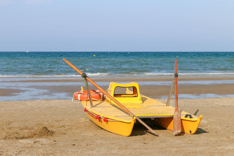 Lifeboat at the beach, Italy, Riccione Italy. Riccione Lifeboat Rimini Vacations Beach Clear Sky Day Emergency Equipment Horizon Horizon Over Water Italy Lifebuoy Mode Of Transportation Nautical Vessel No People Outdoors Paddle Resort Riccione Sand Sea Sky Transportation Water Yellow