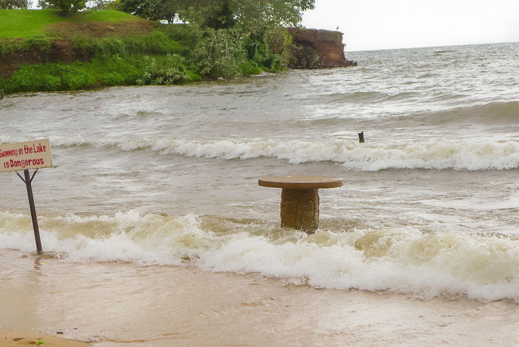 a beach of Uganda Entebbe, Uganda, Victoria Lake, Africa, Beach Beauty In Nature Day Motion Nature No People Outdoors Sand Sea Sky Water Wave