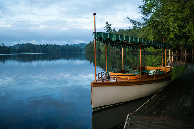 St. Regis Lake Boat Building Exterior Built Structure Canal Connection Engineering Environmental Conservation House Journey Lake Leading Mode Of Transport Moored Nature Nature_collection Naturelovers Nautical Vessel Outdoors Reflection River Transportation Water Waterfront