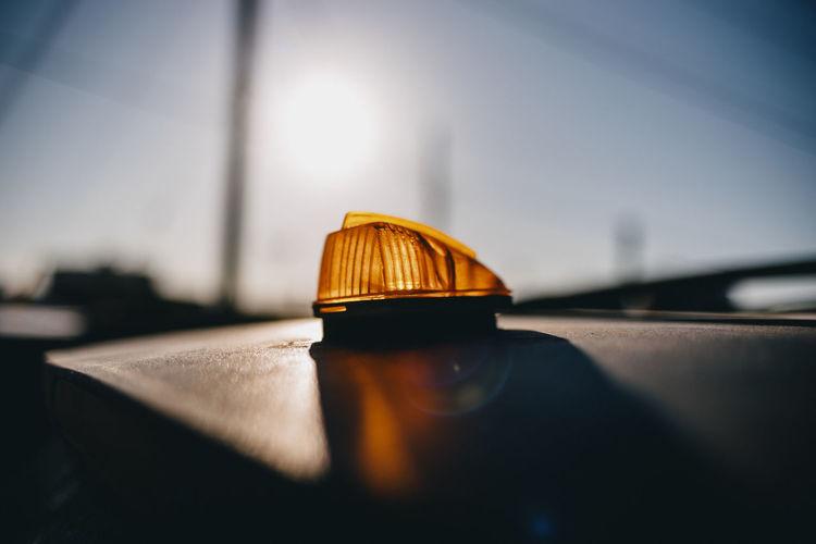 Orange taxi light on roof.