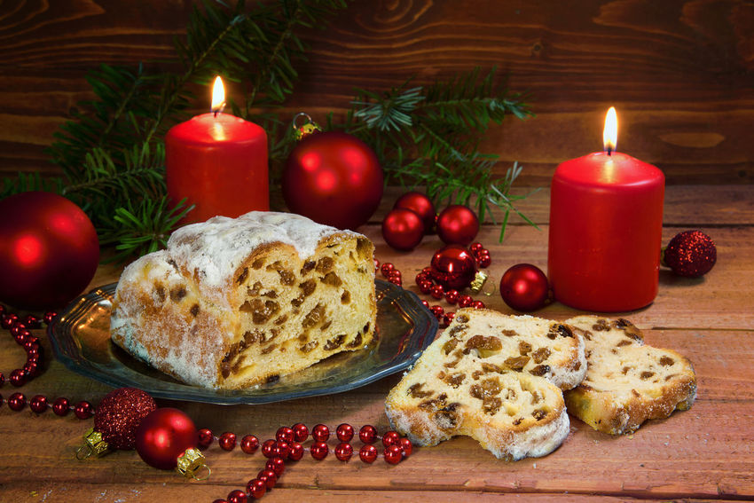 festive christmas cake, german criststollen with raisins and almonds, decorated with burning candles, red christmas balls and fir branches on a rustic wooden background German Advent Ball Bauble Burning Cake Candle Celebration Christmas Christmas Decoration Christmas Ornament Christmas Tree Christstollen Close-up Dessert Flame Food Food And Drink Holiday - Event Illuminated Indoors  No People Red Sweet Food Table