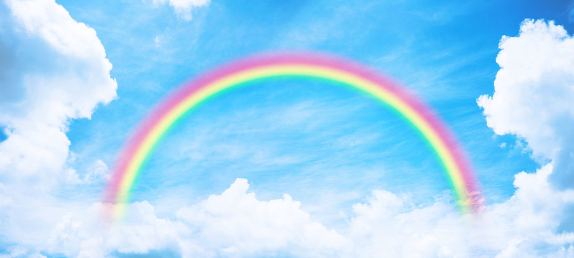 Low angle view of rainbow in sky