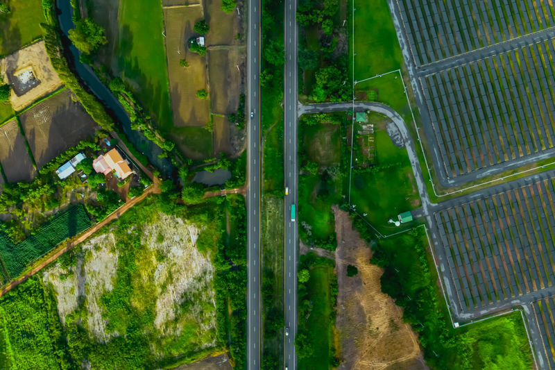 Aerial view of road amidst land
