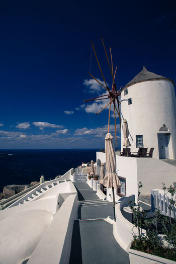 Oia village in Santorini island, Greece. Cityscapes Grecia Greece Greek Islands Grèce, Greece, Island Landscapes With WhiteWall Oia Oia Santorini Santorini Santorini Island Santorini, Greece Sea Seascape Seaside Travel Travel Photography Village Windmill