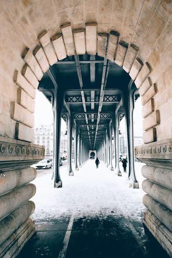 People in snow covered bridge