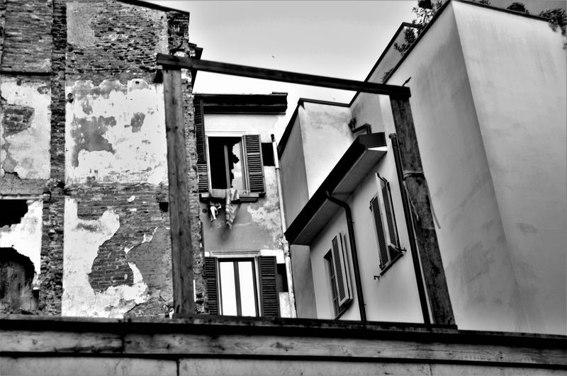 Abandoned Architecture Building Exterior Built Structure Day Decay Frame Low Angle View Neighborhood No People Outdoors Poor  Run-down Sky Suburbia Window
