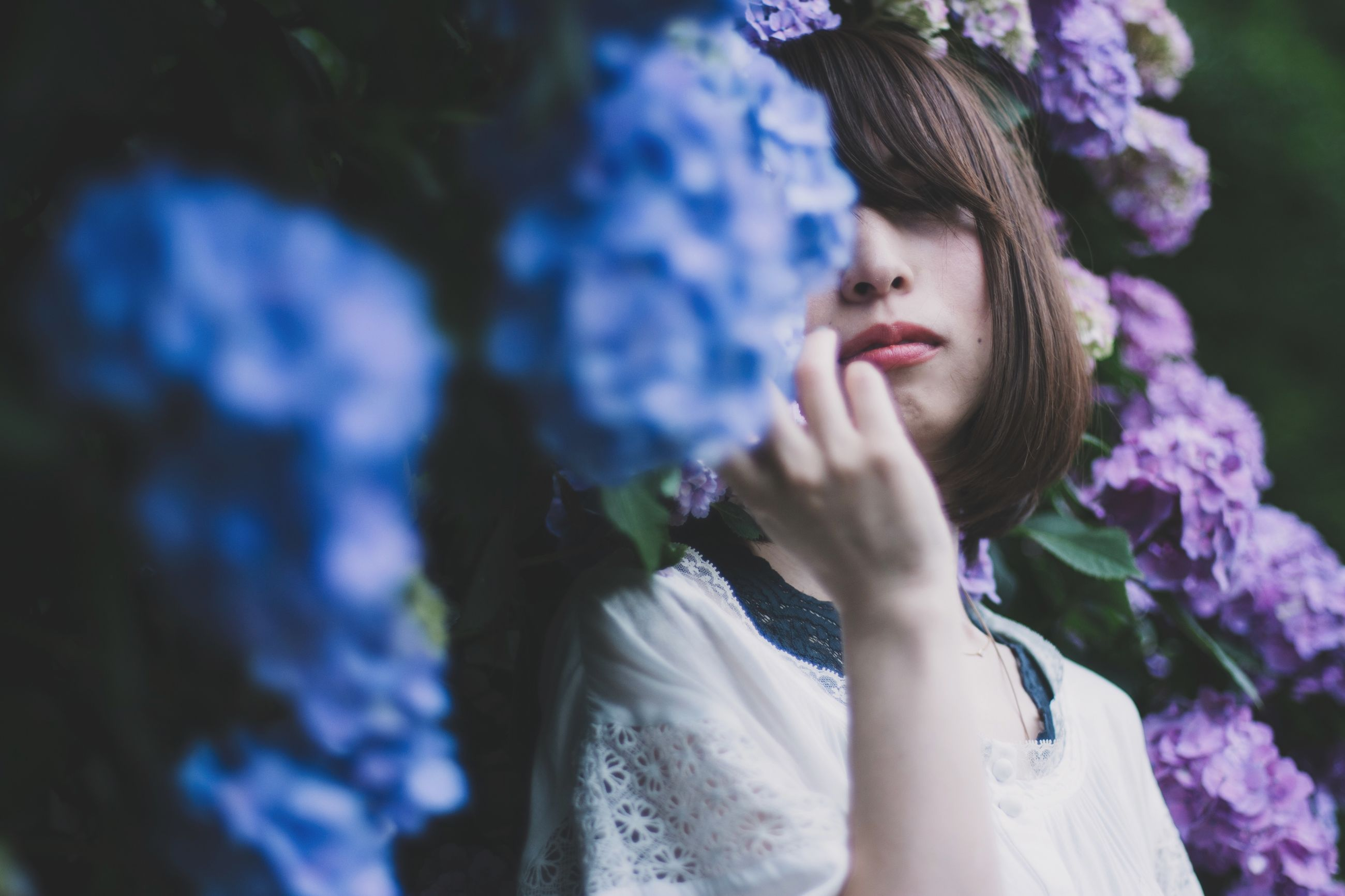 one person, young adult, real people, leisure activity, plant, young women, women, lifestyles, flower, headshot, selective focus, flowering plant, portrait, day, adult, looking, nature, front view, outdoors, beautiful woman, purple