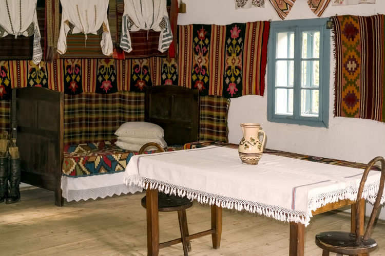 Traditional Romanian folk house interior with vintage decoration Romanian  Romanian Tradition Romanian Culture Traditional Culture Traditional Clothing Absence Architecture Building Chair Clothing Curtain Cushion Domestic Room Electric Lamp Flooring Furniture Home Home Interior Home Showcase Interior House Indoors  Lighting Equipment No People Old Decades Old Decoration Old House Ornate Pillow Roberto Sorin Seat Stuffed Table Tablecloth Traditional Vintage Vintage Decoration Window The Still Life Photographer - 2018 EyeEm Awards