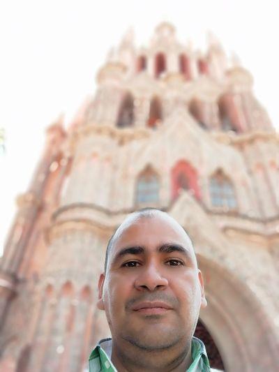 Low Angle Portrait Of Mature Man Against Historic Building
