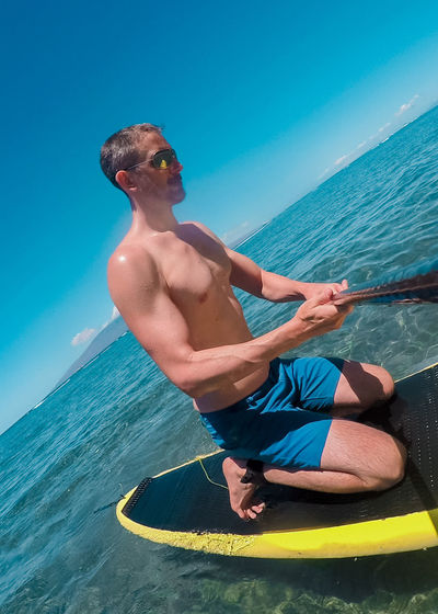 Man on sup standup paddle board off the coast of Maui Hawaii. Camera on selfie stick paddle. Action Camera Day Fitness Full Length Gopro Hawaii Health Island Leisure Activity Man Maui Men Muscle Nature Outdoor Recreation Outdoors Paradise People Real People Selfie Standup Paddleboarding Tropical Vacations Water