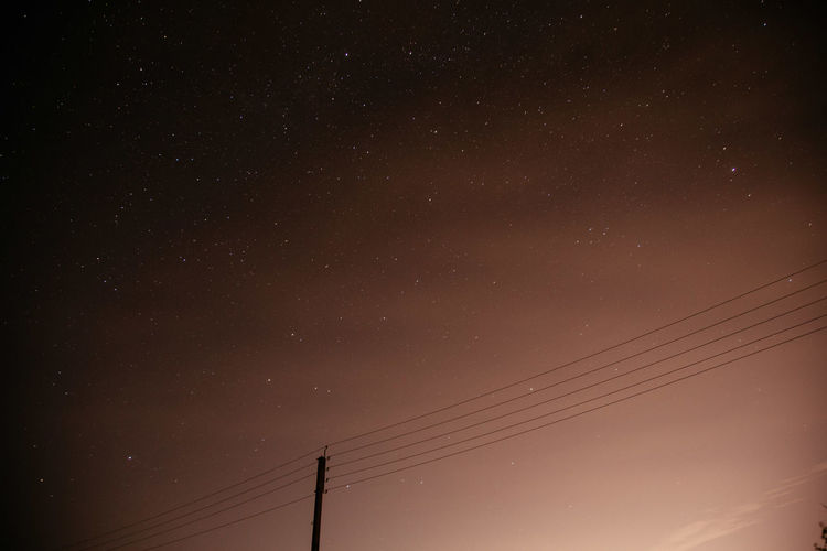 Sky and Stars Cosmos Astronomy Beauty In Nature Cable Cold Cold Temperature Connection Electricity  Electricity Pylon Galaxy Long Exposure Low Angle View Nature Night No People Outdoors Power Line  Scenics Silhouette Sky Skyporn Space Star Technology
