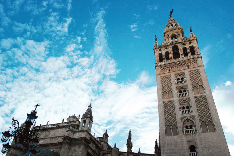 Architecture Building Exterior Built Structure City Cloud - Sky Cultures Day Giralda Giralda Cathedral Low Angle View No People Outdoors Sevilla Seville Sky Tourism Tower Travel Travel Destinations