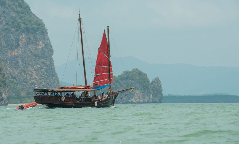 Boat in the Bay, Phang-Nga, Thailand Beauty In Nature Day Mode Of Transport Nature Nautical Vessel Outdoors People Sailboat Sailing Sea Sky Travel Travel Destinations Vacations Water Waterfront