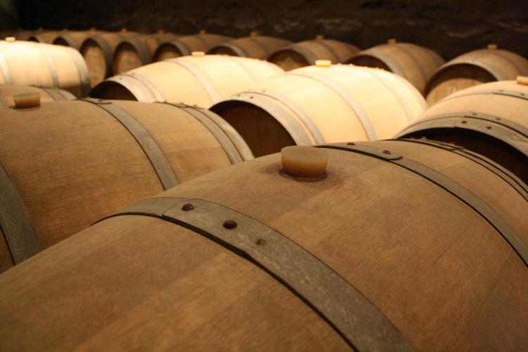 Close-up of wine barrels in cellar