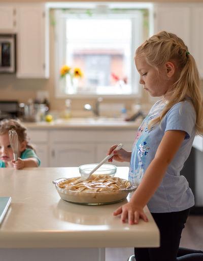 Girl having food at home