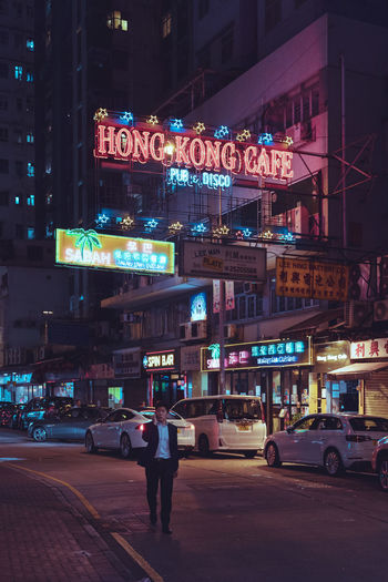 Light Nightlife Outdoors Commercial Sign Neon City Street Mode Of Transportation Transportation Road Western Script Car Motor Vehicle City Life Street Sign Night Communication Built Structure Text Illuminated Architecture Building Exterior City EyeEm Gallery EyeEm Selects EyeEm Best Shots Wan Chai One Person Tones Neon Sign Neon Lights 香港 灣仔
