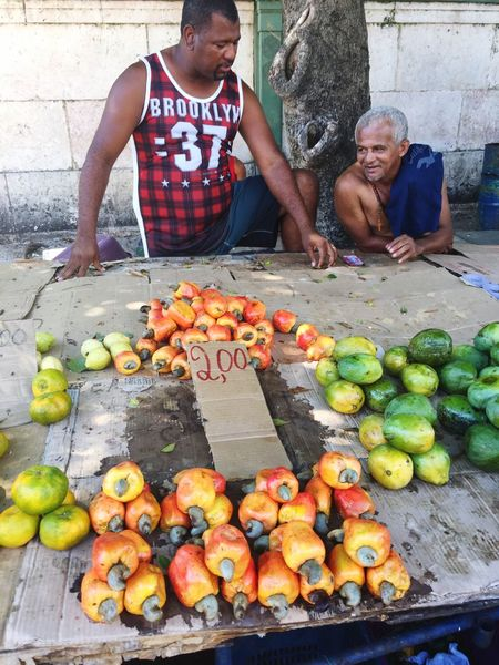 EyeEm Selects Fruit Freshness Market Healthy Eating Outdoors Food And Drink Day Food Vegetable Men Caju Two People Adult Real People People Recife, Brazil Brazil Only Men Young Adult Elder Cashews Cashew Cashew Fruit Cashew Fruits Investing In Quality Of Life Business Stories