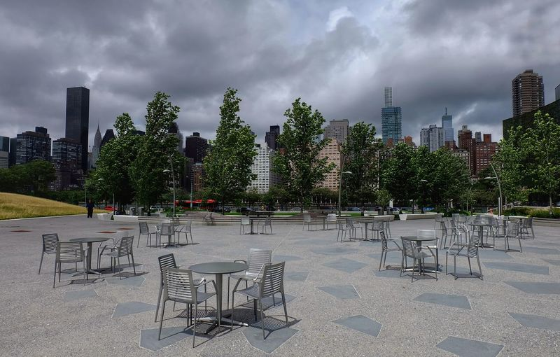 Take a table, any table. Fuji Xa1 Tables And Chairs Outside Outdoors Landscape Sky And Clouds Photography Sunlight And Shadow Plaza De Roosevelt Island Tree City Urban Skyline Chair Cityscape Outdoor Chair Sky Cloud - Sky Overcast Atmospheric Mood Weather Dramatic Sky Empty