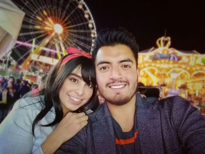 Happiness Smiling Two People Portrait Young Women Heterosexual Couple Cheerful Young Adult Couple - Relationship Toothy Smile Fun Togetherness Women Beautiful People Looking At Camera Young Couple Selfie Girlfriend City Fair Night Couplegoals