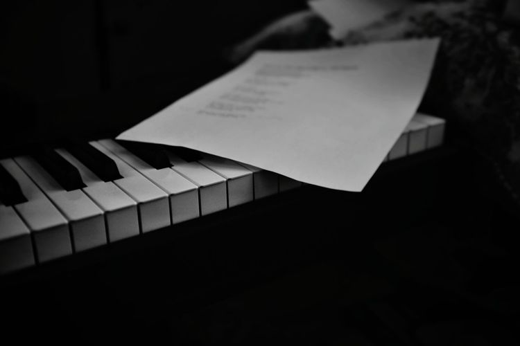 High angle view of piano keys against black background