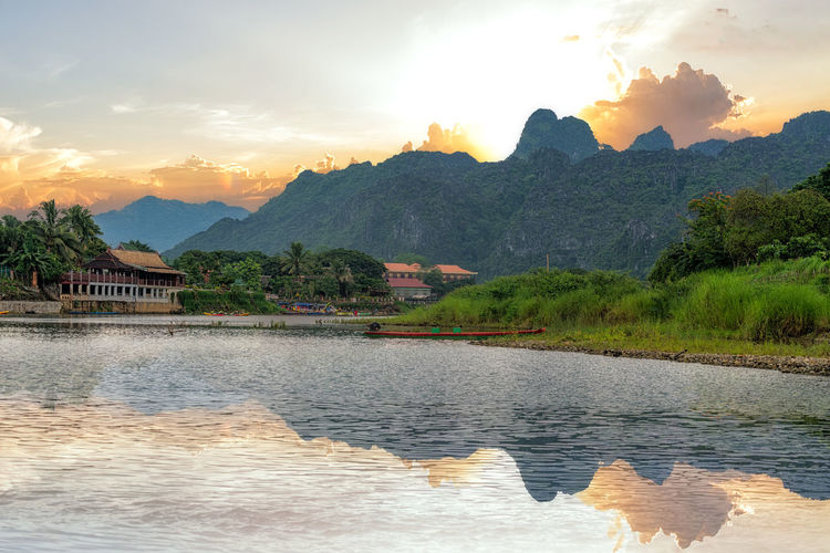 Landscape of Song River view at Vang Vieng, Laos Architecture Beauty In Nature Cloud - Sky Day Idyllic Lake Landscape Mountain Mountain Range Nature No People Outdoors Range Scenics Sky Sunset Tranquil Scene Tranquility Travel; Asia; Mekong; Water; Tourism; Tropical; Southeast; Blue; Summer; Beautiful; Outdoor; Vacation; Environment; Mountain; Asian; Scenery; Rural; Tree Vieng; Vang; Laos; River; Landscape; Song; Nature; Green Water