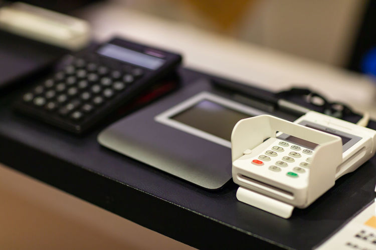 Credit card reader on table in store
