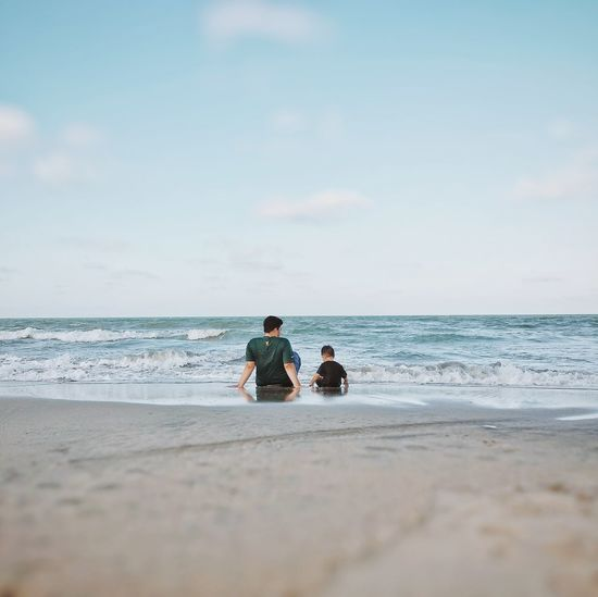 father and toddler son sit on the beach Happiness Grateful Love Water Sea Child Togetherness Beach Bonding Low Tide Men Sand Childhood Single Parent Shore Wave Parent Tide Sandy Beach Young Family Horizon Over Water Family Bonds Calm Summer Exploratorium This Is Family
