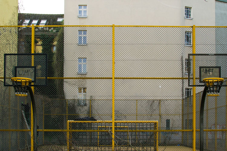 Basketball Court Against Building In City