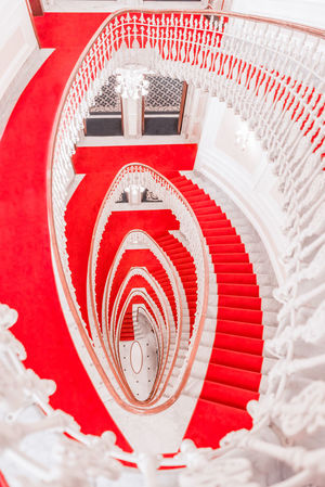 Above view with spiral staircase - Interior spiral marble stairs from a luxury building covered with a red carpet, viewed from above. Architecture Classic Architecture Elégance Spiral Staircase Spiral Stairs White Stairs Above View Architecture Elegant Building Hotel Interior Hotel Stairs Indoors  Interior Stairs Marble Staircase Marble Stairs Red Red Carpet Red Carpet Stairs
