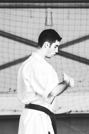 New Year's Resolutin: Train Harder! Balance Black And White Concentration Concentrationcamp Equilibrium EyeEm Best Shots Instructor Karate Martial Arts Martial Arts Children Mentor New Years Resolutions 2016 Photooftheday Showcase: December Sitting The Week Of Eyeem Train Hard Training Work Hard Play Hard Working Hard Alternative Fitness Finding New Frontiers
