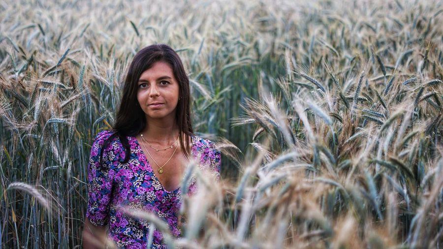 Portrait of woman standing in field
