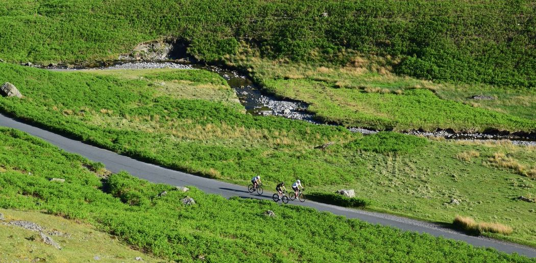 Cycling Uphill Battle Honister Pass Honisterpass Lakedistrict Beauty In Nature Day Environment Field Grass Green Color Growth High Angle View Land Landscape Nature Non-urban Scene Outdoors Plant Rural Scene Scenics - Nature Tranquil Scene Tranquility Tree Water