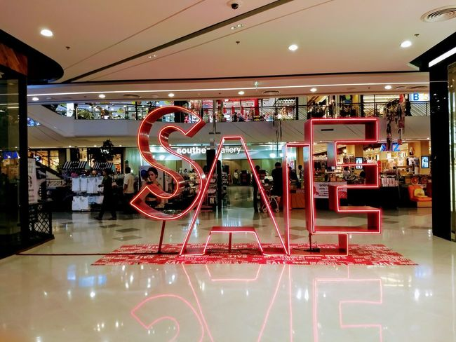 Yah! It's on sale! huhuhu Store Neon Consumerism Text Illuminated Day Architecture Bar - Drink Establishment Retail  No People Price Tag Indoors  Department Store