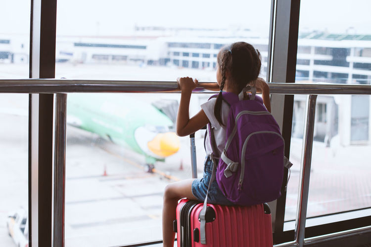 Airline Airplane Airport Alone Arrival Asian  Back Backpack Bag Baggage Boarding Child Cute Departure Destination Enjoy Family Flight Gate Girl Hall Happy Holiday Indoor Information Inside International Journey Kid Leisure Lifestyle Looking Luggage Passenger People Plane Suitcase Terminal Thai Together Tourism Tourist Transit Transportation Travel Trip Vacation Voyage Waiting Young