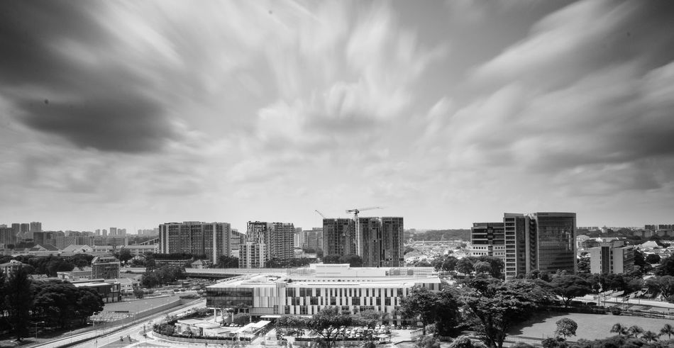Architecture Blackandwhite Bnw Building Exterior Built Structure City City Life Cityscape Cloud - Sky Day Longexposure Modern No People Outdoors Sg Sgarchitecture Singapore Sky Skyscraper Travel Destinations Tree Urban Road Urban Skyline