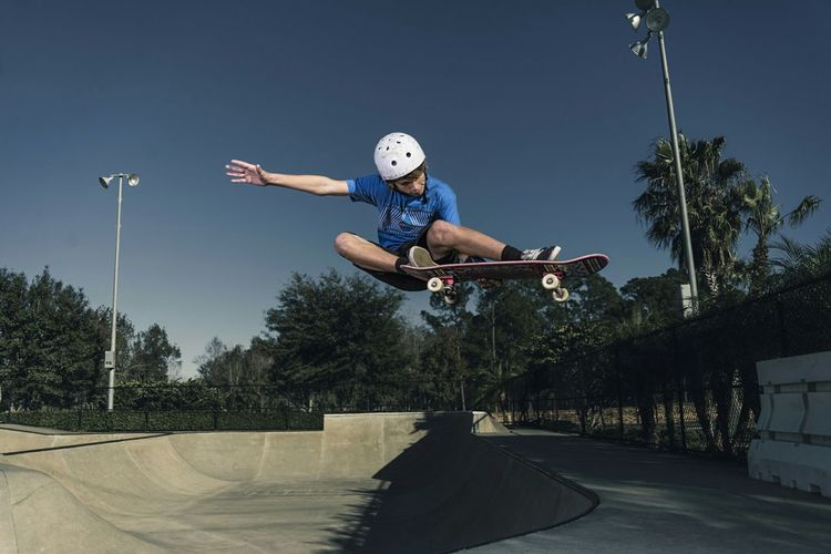 Capture The Moment a quick launch out of the bowl during a little skate session Skateboarding Action Moments