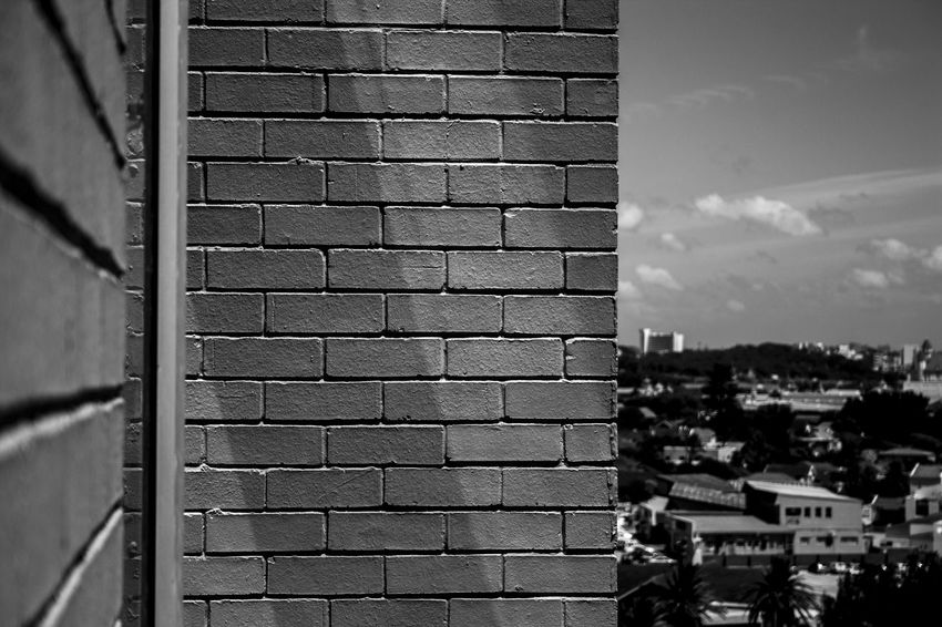 Walls of light. Architecture Blackandwhite Brick Wall Building Exterior Built Structure City Contrast Day Light And Shadow No People Outdoors Pattern Shadow Sky Wall Exploring Style