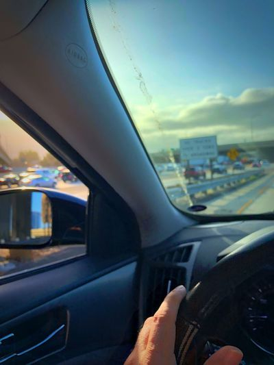 Traffic Mode Of Transportation Transportation Human Hand Car Human Body Part Vehicle Interior Motor Vehicle Hand Cloud - Sky Steering Wheel Car Interior