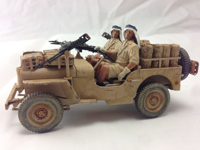 Close-up of statue of army solider sitting on jeep