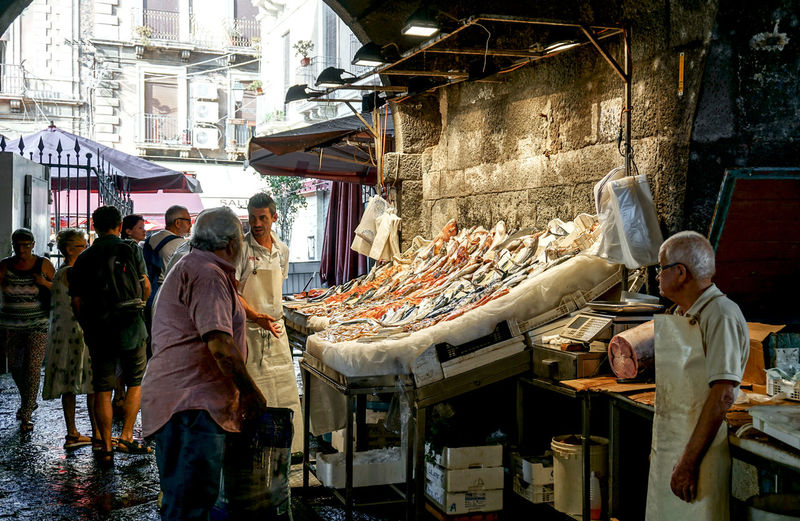 fish market stall in Catania, Italy Market Retail  Market Stall Real People Buying Food Small Business Choice Street Market Catania Sicily Streetphotography Street Photography Light Fish Fish Market Travel Tourism Travel Destinations Sale People Vendor