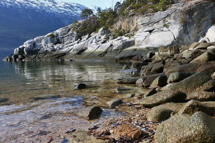 Smuggler's Cove in Skagway, Alaska April 2019 Water Nature Rock Mountain Land Environment Beauty In Nature Solid Rock - Object Landscape No People Day Tranquility Sky Scenics - Nature Outdoors Beach Sea Tranquil Scene Shallow Flowing Formation Ocean Inlet Ocean Inlet Skagway Alaska Smuggler's Cove Low Angle View
