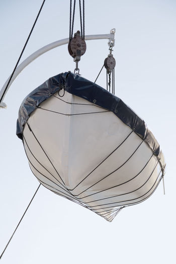 Low angle view of electric lamp against clear sky